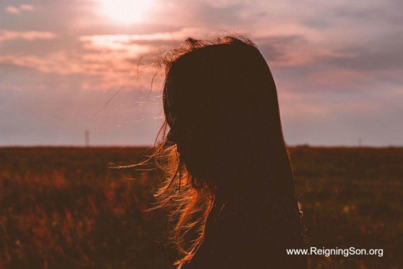 hidden unseen silhouette woman in field